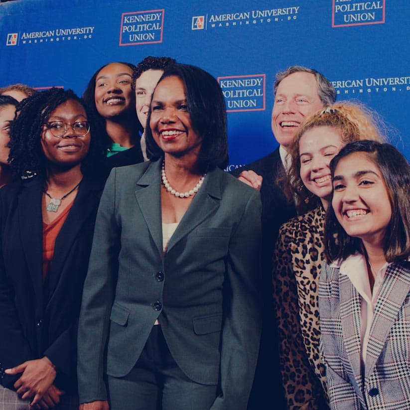 Condoleezza Rice poses with AU students after a speaking event