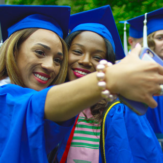 Two students take a selfie during Commencement Weekend