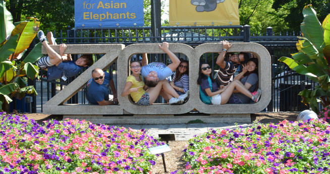 International students pose in the letters spelling out Zoo