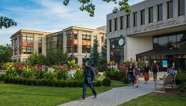 Students walking in front on SIS building