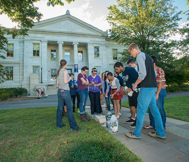 Students participating in a science experiment in the quad.