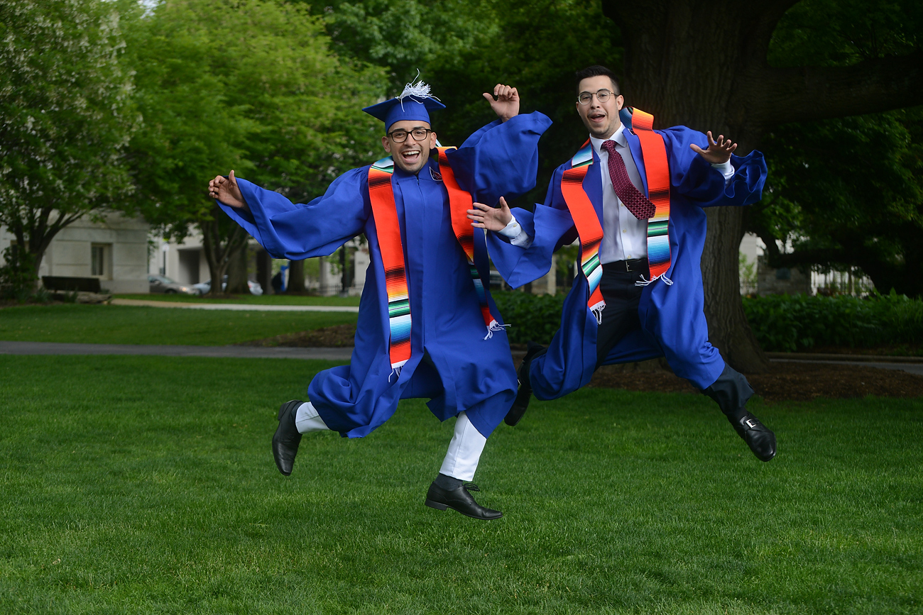 Two AU students jumping for joy at graduation!