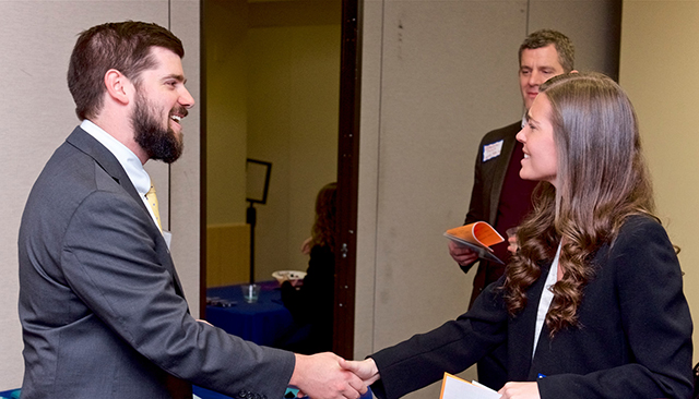 Student and alumnus meet at networking reception
