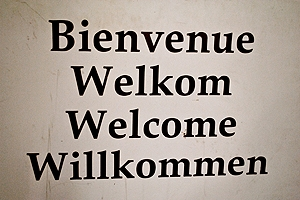 A sign saying Welcome in four different languages