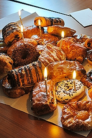 Assortment of Belgian pastries with candles in them for a birthday celebration.