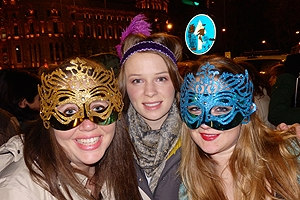 Three students in carnival colorful masks