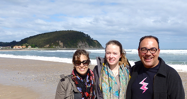 Program Director and Program Coordinator with student on the beach in the north of Spain.