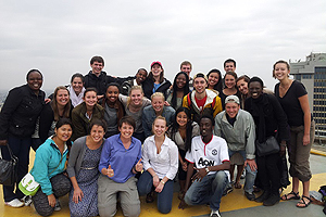 AU Nairobi staff and students on a rooftop.