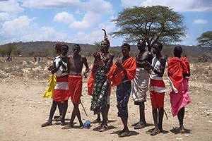 Kenyan Samburu men in their traditional colorful costumes.