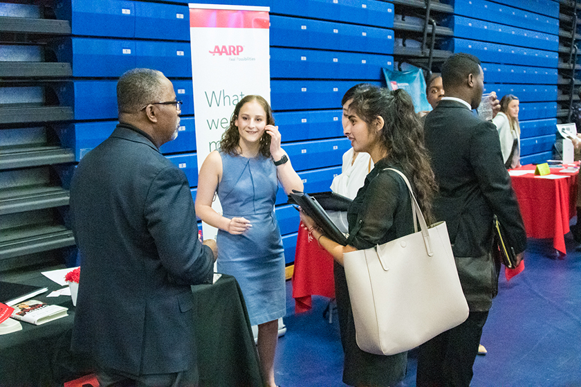 student talks to AARP recruiters at the job and internship fair