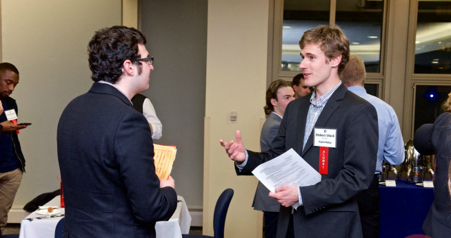 Two people talking at a networking reception