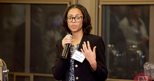 An alumna speaks at an event