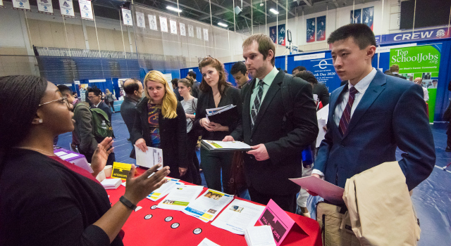 An employer representative speaks to AU students at the Job & Internship Fair