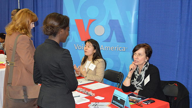 Employer talking with students