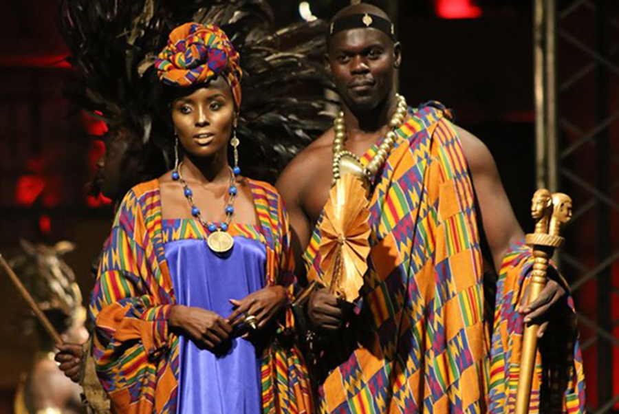 A man and woman dressed in colorful clothes.