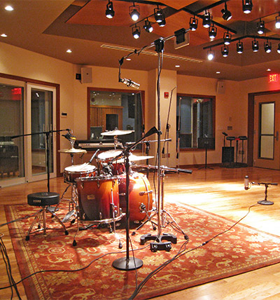 Studio with drum set and mics