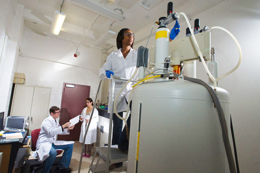 Students works with NMR instrument
