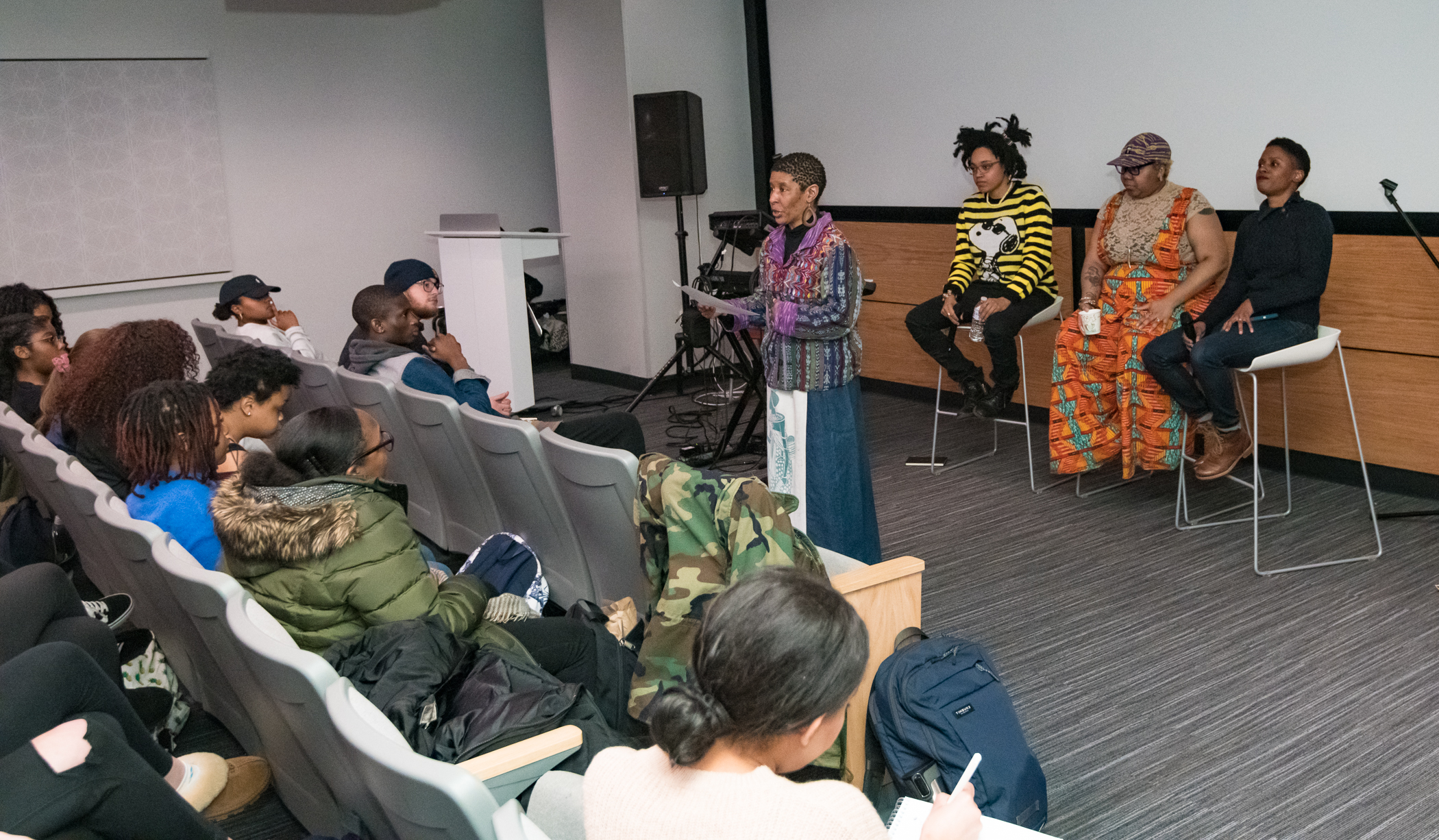 Professors and artists from BOOMscat speak to students