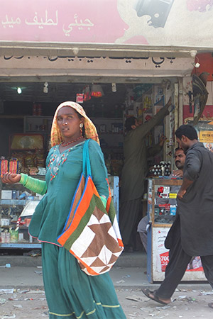Woman in headress in Arabic-language marketplace