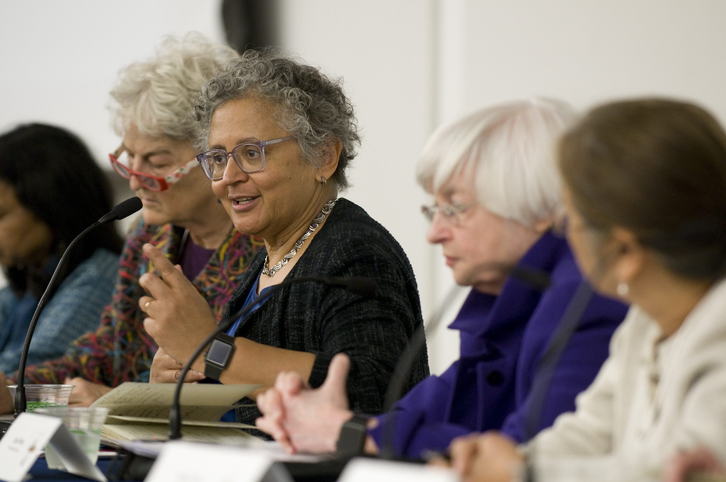 Five women sitting on a discussion panel