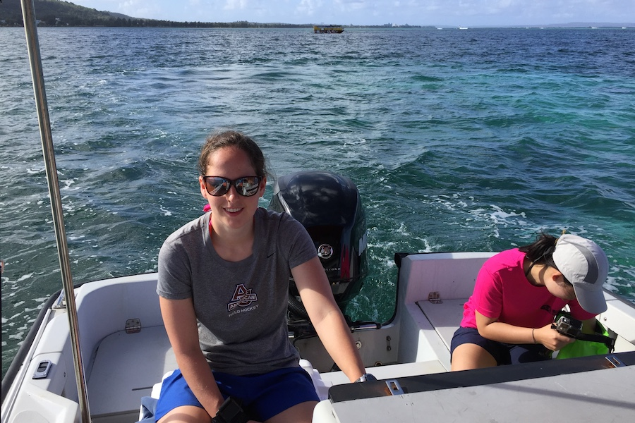 Alex Morris driving the boat used to collect water, seagrass, and algae samples from the reef.