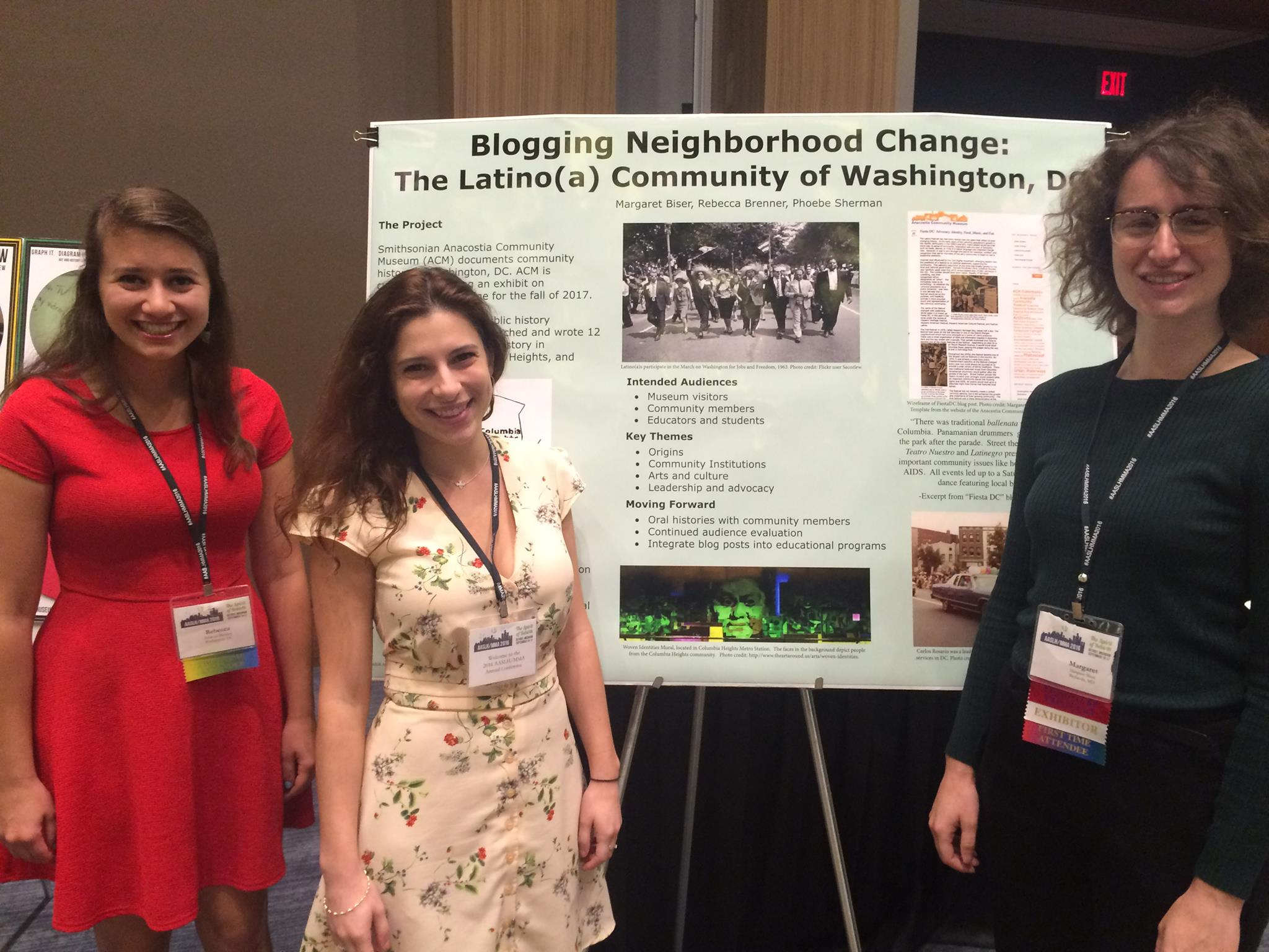 Three students stand with their practicum poster