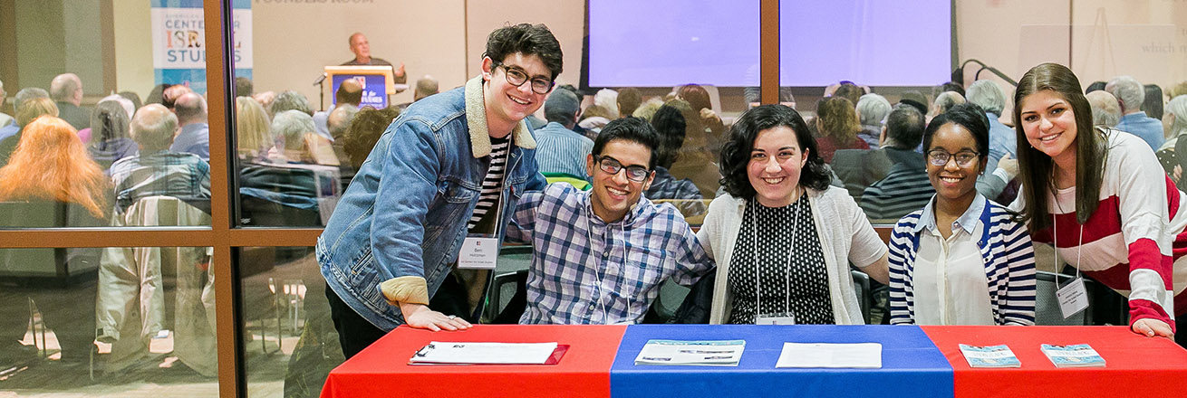 Five students at a table at the Meir Shalev event