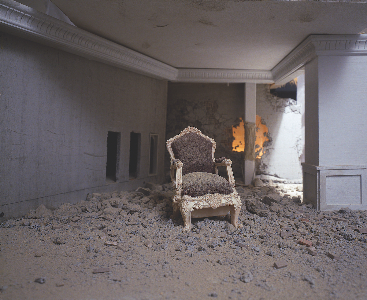 Photograph of a chair inside of a burnt interior