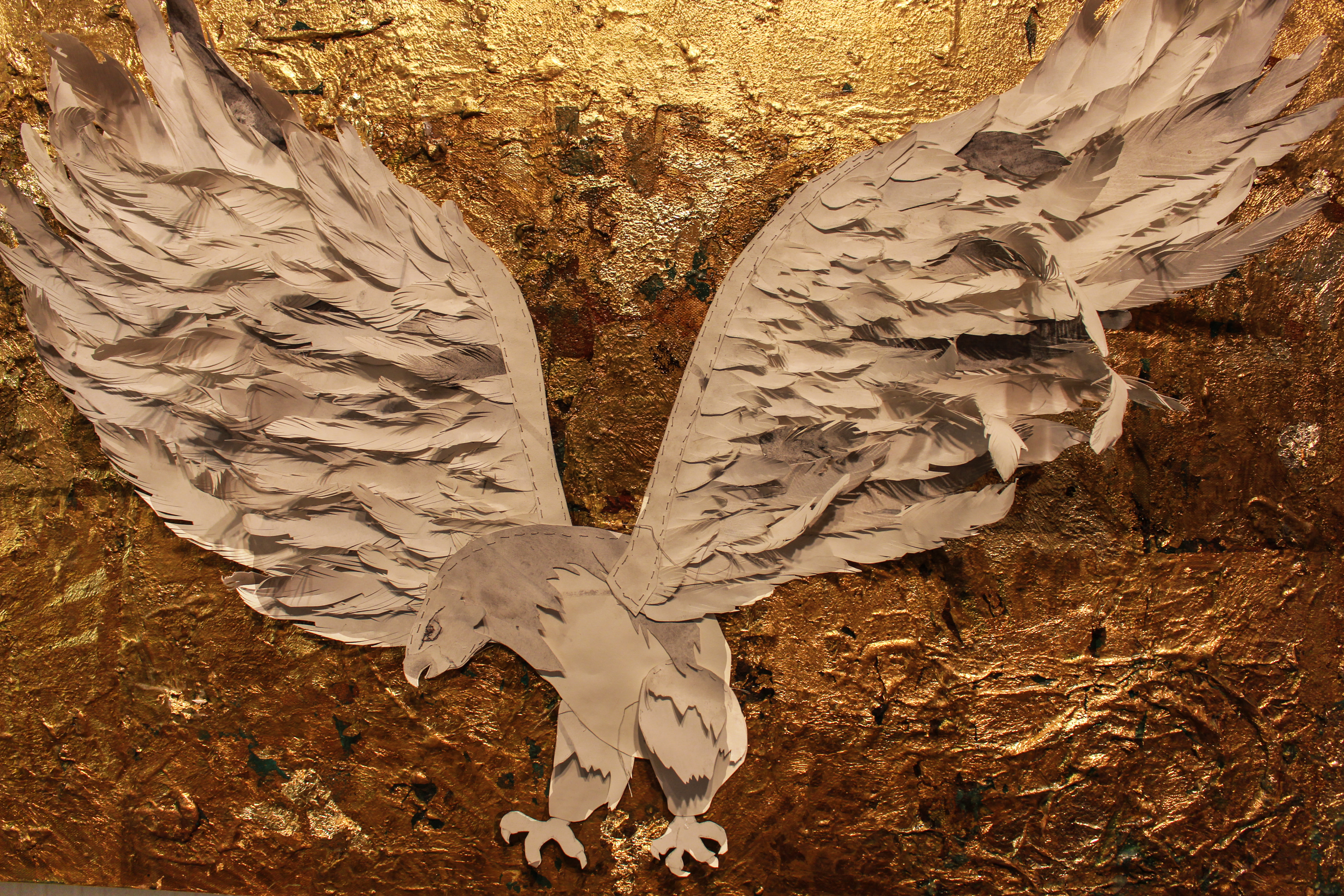 White paper eagle with gold background