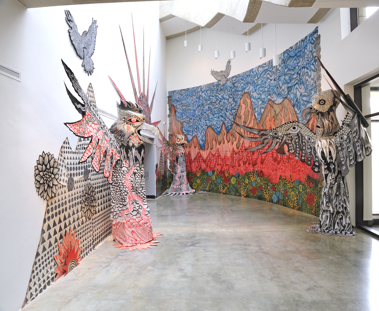 Installation view with screen-printed vultures and wall decoration