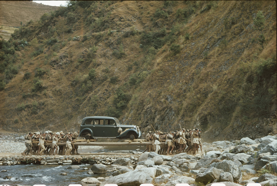 Sixty porters carry a Mercedes from Nepal to Calcutta.