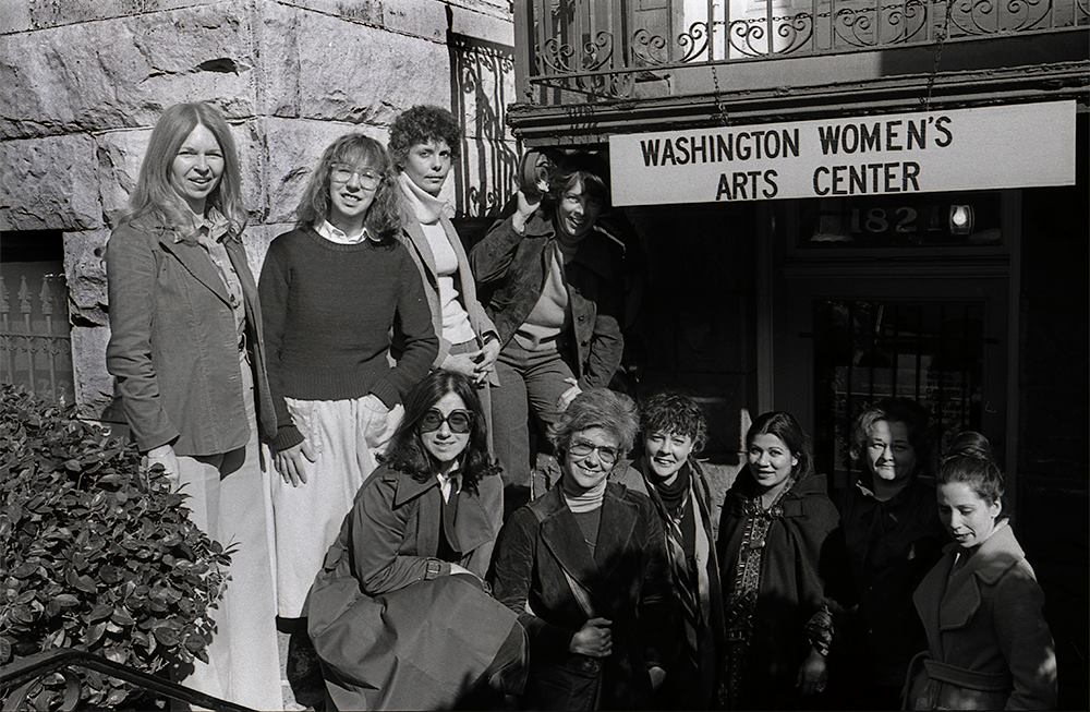 Ten women in front of the Washington Women's Arts Center