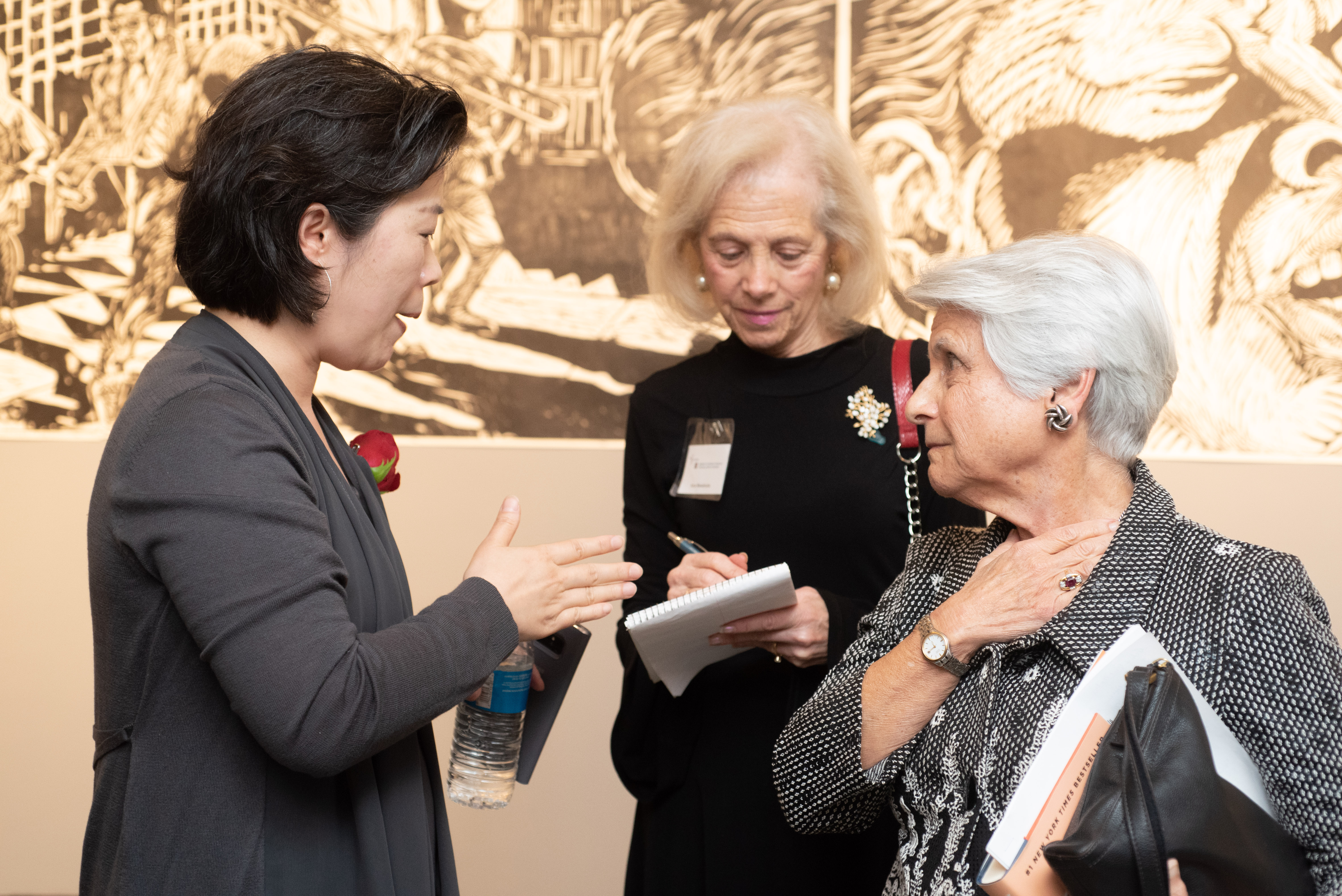 Patrons talking at museum event