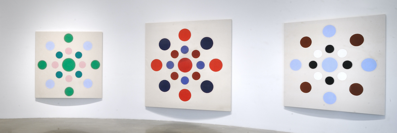 Installation view of geometric paintings