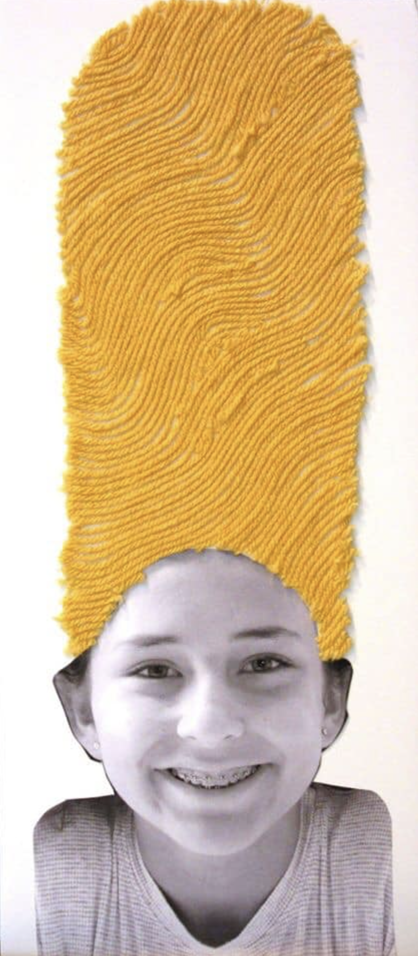 A child with yellow yarn for hair