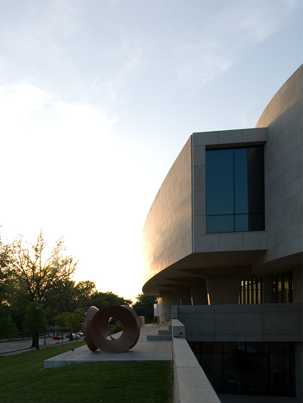 Museum and sculpture at sunset.
