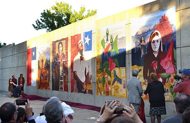 Chilean President in front of mural with audience at AU Museum