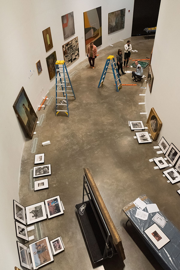 The Moves Like Walter exhibit being installed, seen from overhead
