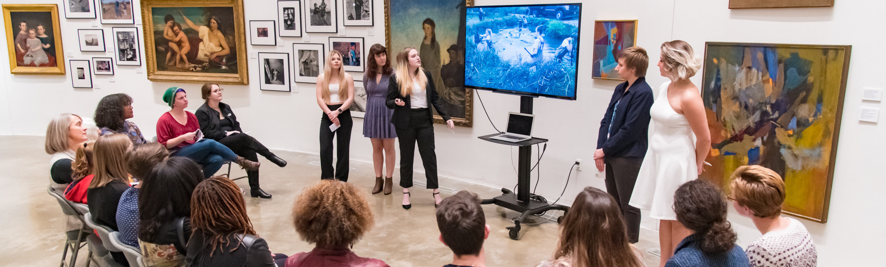 Dancers discuss sustainability practices with an audience in the American University Museum