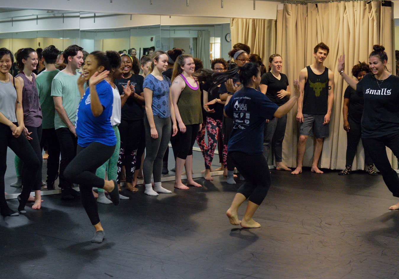 Students travel across the floor in a master class with Charles O. Anderson