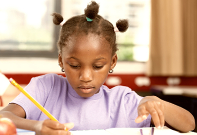 Child works on schoolwork at a desk