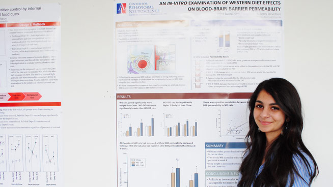 Student presents at poster session