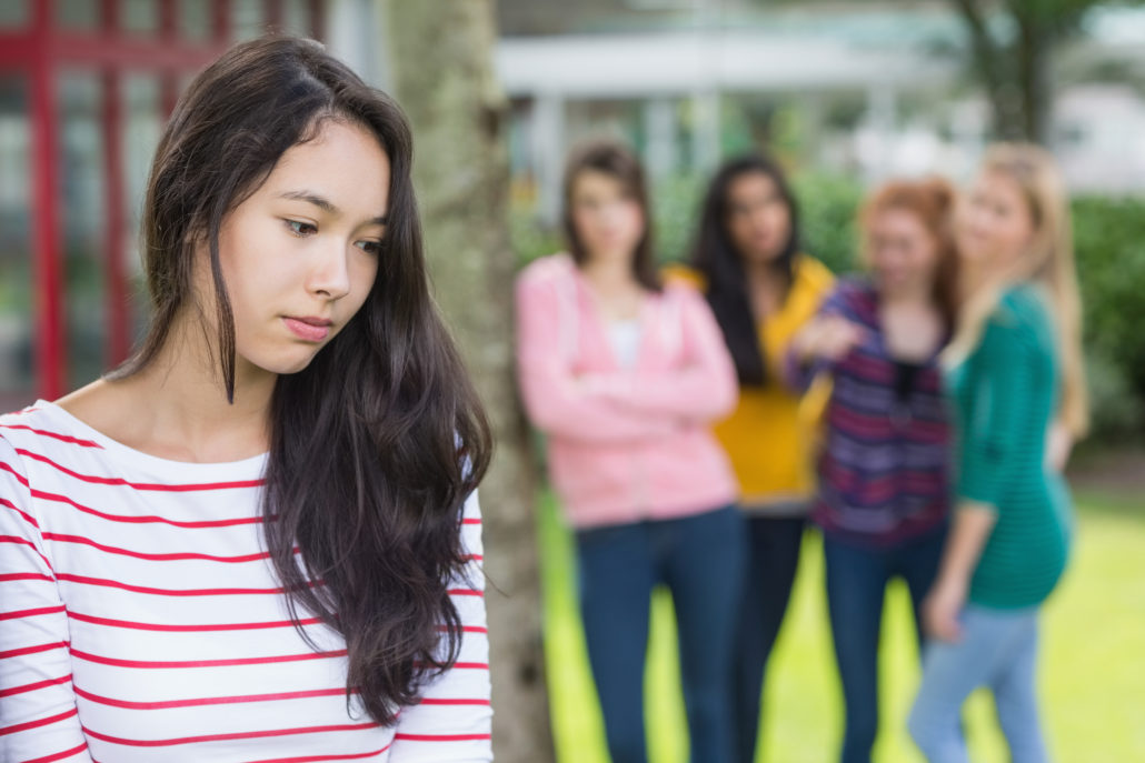 Teens bullying a peer