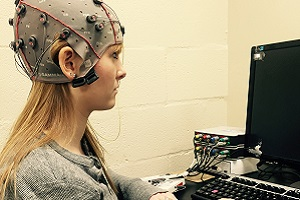 Student in EEG device