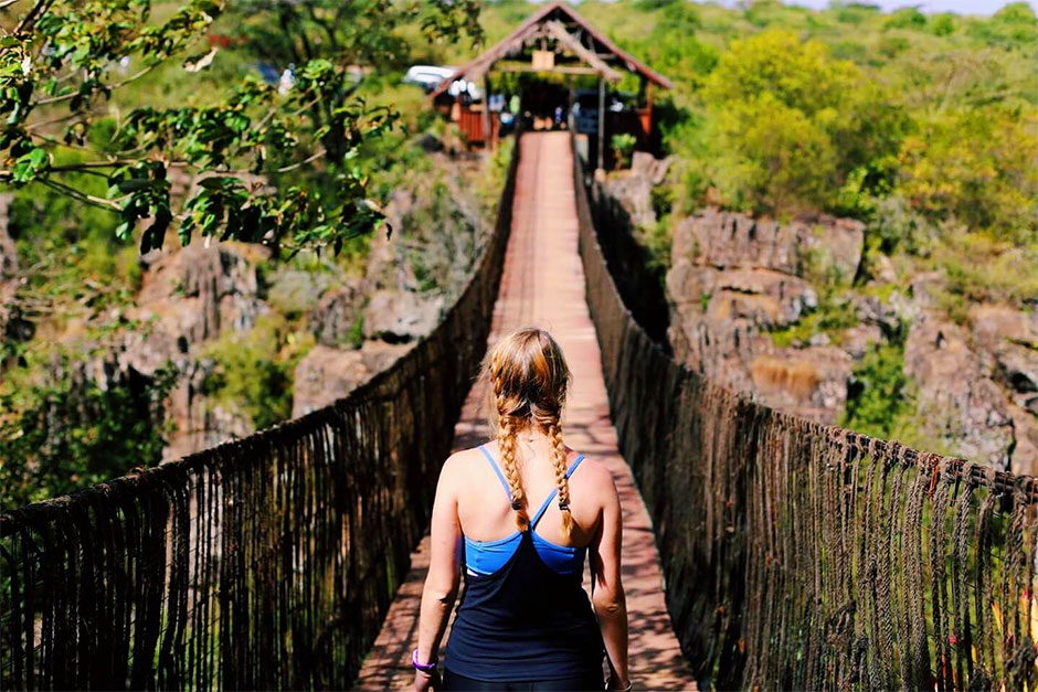 Study abroad student on bridge in Kenya.