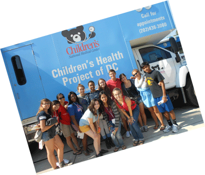 Interns in front of CHP van