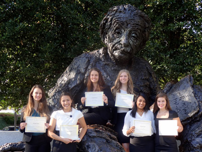 Students stand near statue of Einstein