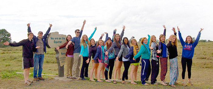 Students stand on the equator in Kenya