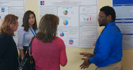 Student presents a poster