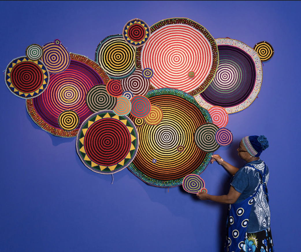 Xenobia Bailey making artwork on a wall